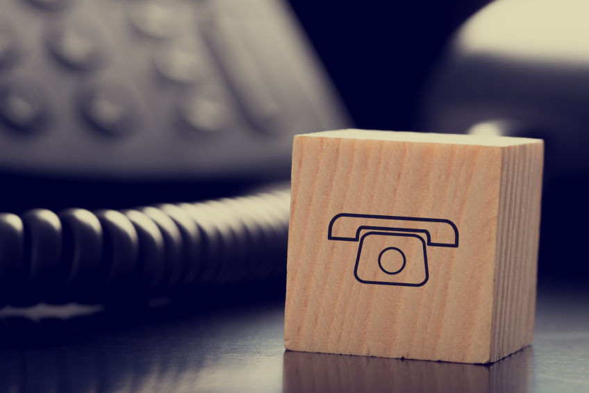 Block with Graphic of Phone in front of Telephones