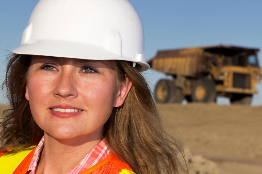 Female Worker and Dump Truck